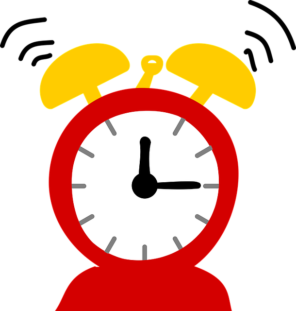 Red and yellow depiction of a ringing alarm clock with hands at 12:15