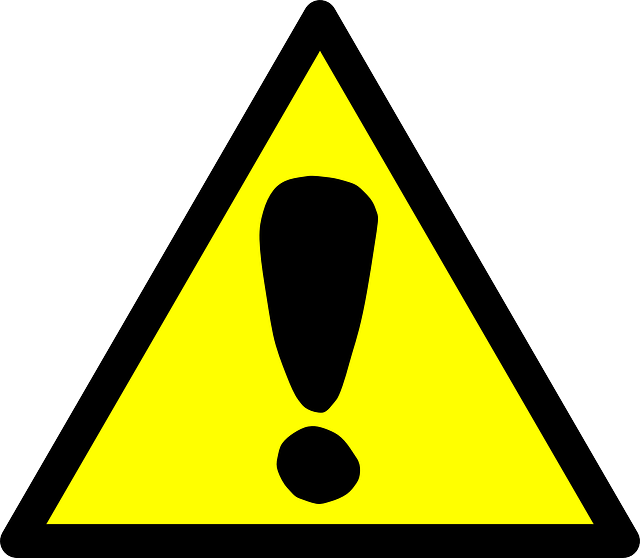 Yellow, triangular shaped sign with a black exclamation point on it