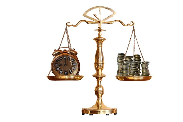 Old-style scales balanced with an alarm clock on the left side and several stacks of coins on the right