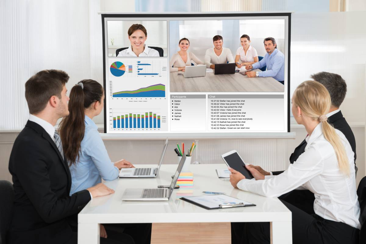 Four Business people video conferencing with colleagues