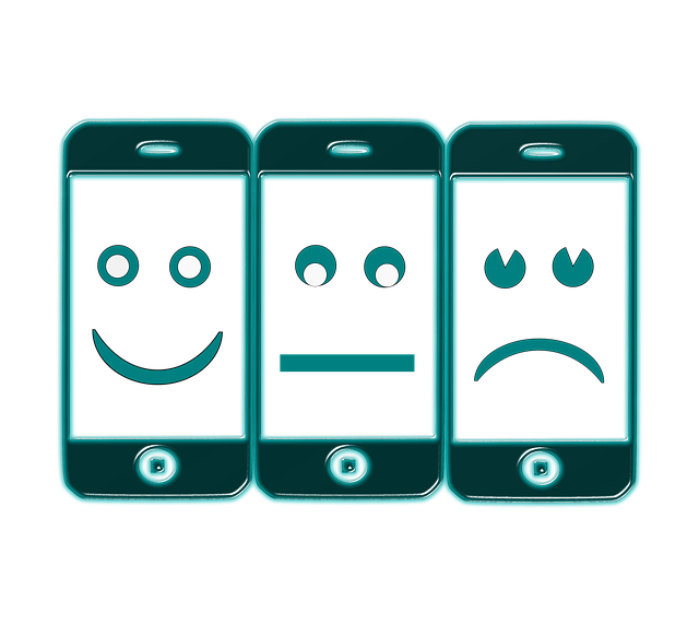Three smartphones with happy, neutral, and sad faces on them