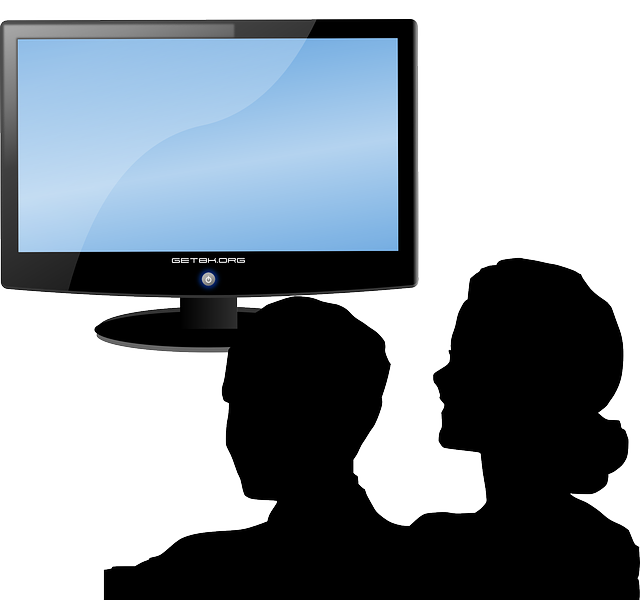 Silhouette of the heads of a man and woman set next to an image of a desktop monitor