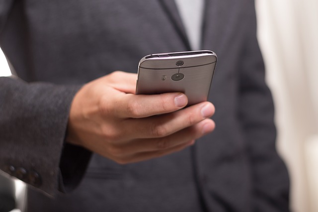 Businessman using a smartphone with his right hand